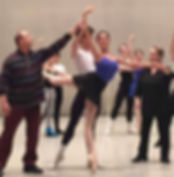 Bolshoi Ballet Academy teachers Georgii Gusev and Natalya Revich correct the placement of the arms for a partnering couple as the male supports the female in attitude derrière en pointe.