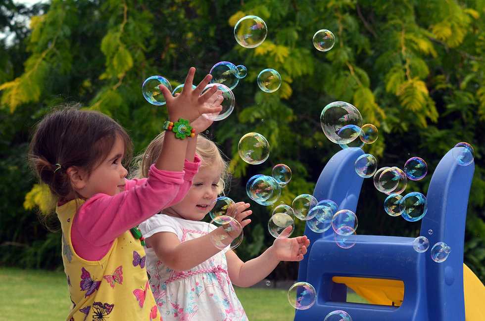 children playing with bubbles.jpg