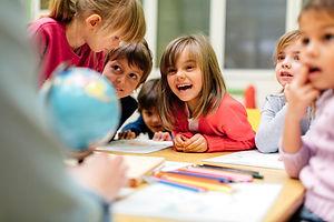 children learning and smiling.jpg