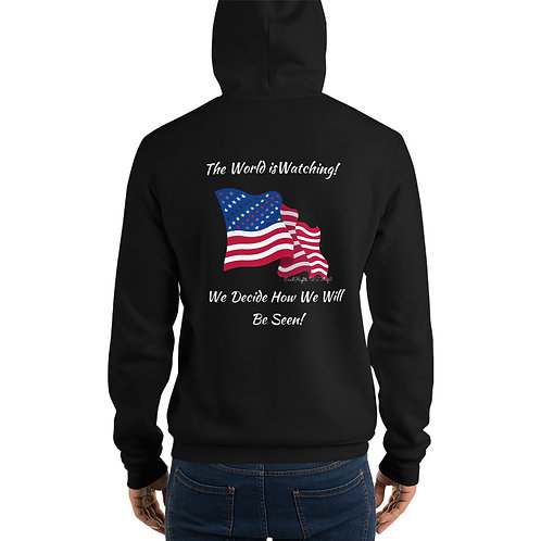 Man wear black Hoodie with the Civil Rights US flag on it, and the words The world is watching