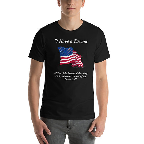A man wears a black t-shirt with the Civil Rights US flag on it, and the words I have a dream