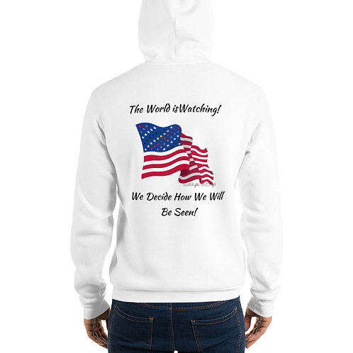 Man wear white Hoodie with the Civil Rights US flag on it, and the words The world is watching