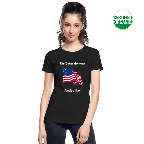 A girl wears a black t-shirt with the Civil Rights US flag on it, and the words That's how America looks like