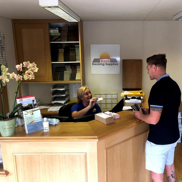 Caroline trade counter with Shane.jpg