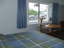 Room 1. King Bed, Outdoor Seating.