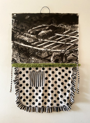 """Asado, 2017, India Ink on Arches, moss fringe, cotton apron, metal wire, African beads, 30 x 56""""h"""