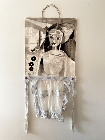 "LIVING DOLL, 2018, India Ink on paper, antique apron, polyester flowers, rhinestones, paper wrapped stem wire, 22 x 56"" h"