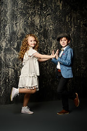 Happy child boy and girl are posing toge