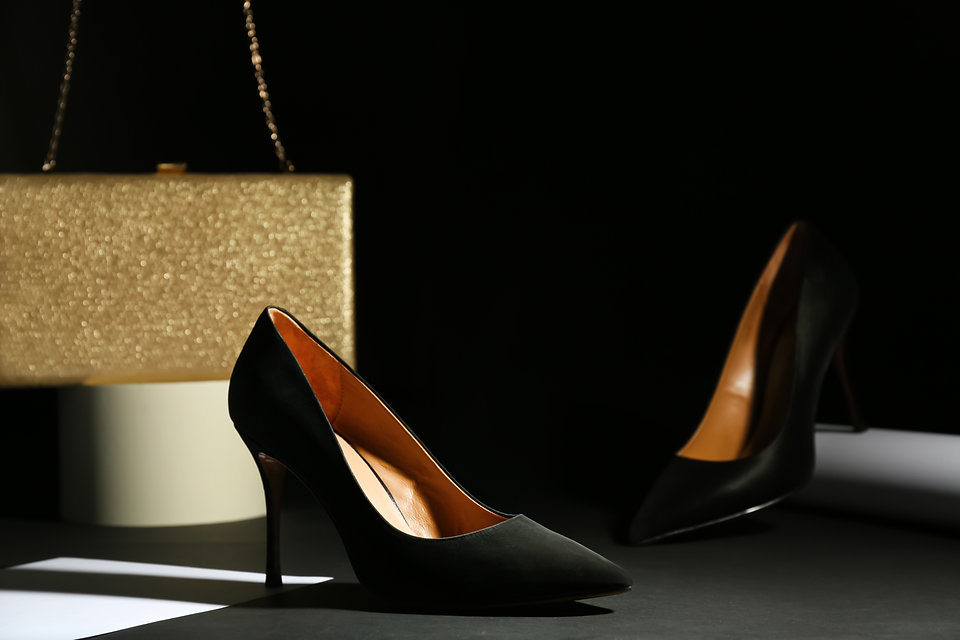 Pair of elegant high heel shoes and clut