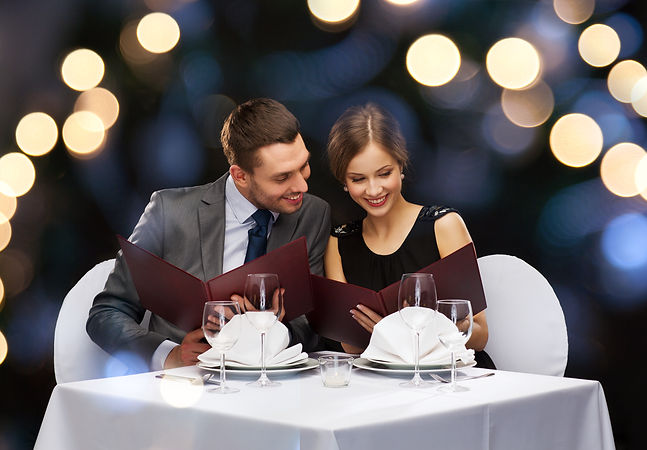 restaurant, couple and holiday concept -