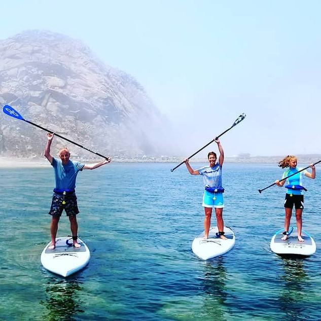 Family of paddleboarders.