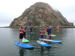 Family of six on paddleboards.