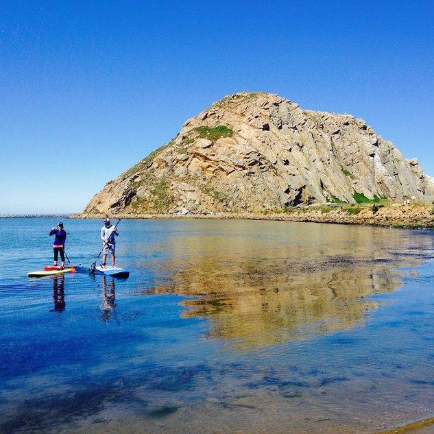 Calm water reflection of Morro Rock.