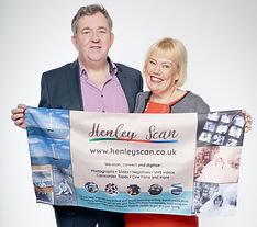 Henley Scan founders with banner