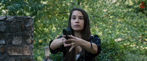 Mia and gun.png