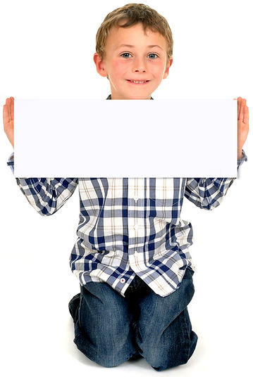 boy holding a sign