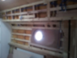 Fitting the porthole on the starboard side of the Humber keel liveaboard houseboat