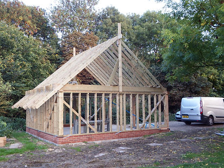 oak framed garage with a new cut and pitched roof in Kent
