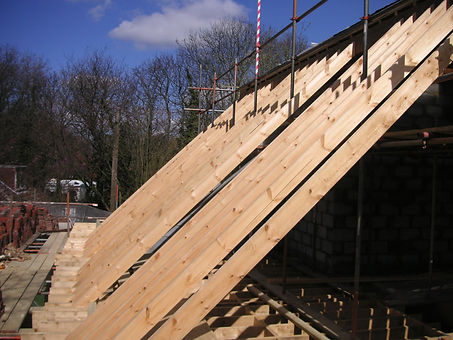 carpenters in kent fitting a cut and pitch roof fitting the common rafters