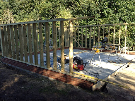 Timber frame construction garage being built by local carpenters