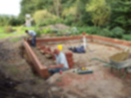 bricklayers laying the face brickwork for the oak framed garage