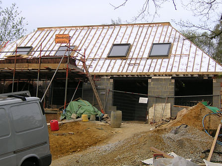 Carpenters in Kent fitting insulation to roof ready for roof tiles