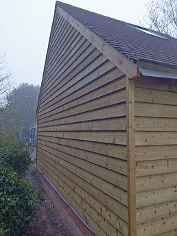 oak framed garages with softwood cladding in Faversham Kent