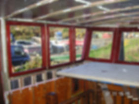 Local carpenters in Kent made these bespoke windows for the barge wheelhouse