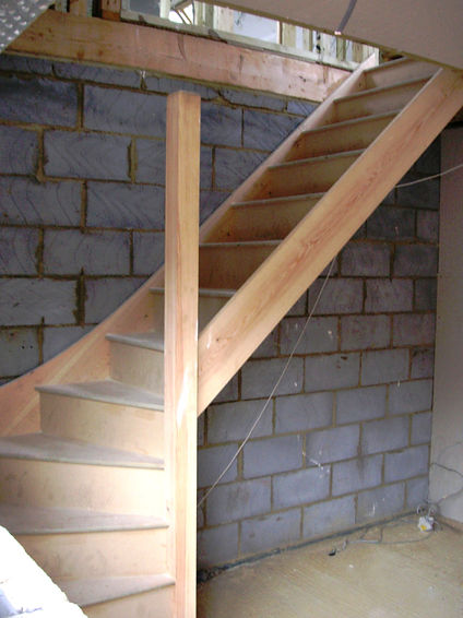 Carpenters in Kent fitting the new staircase on the loft conversion in Harrietsham Kent