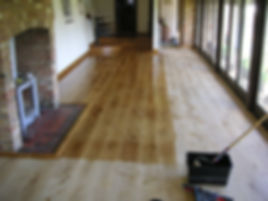 local carpenters refinishing a wide board oak floor in Faversham Kent