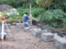 Bricklayers laying the first course of blocks for the oak framed garage