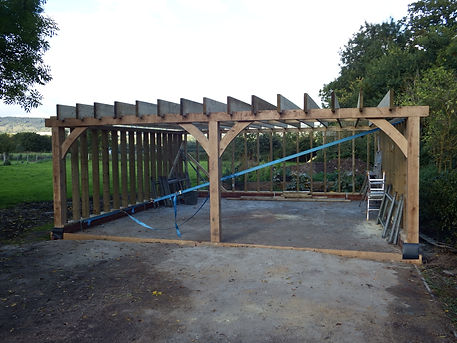 Oak posts and oak beams with oak wind braces and softwood stud walls.