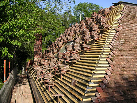Carpenters in kent laying out roof tiles