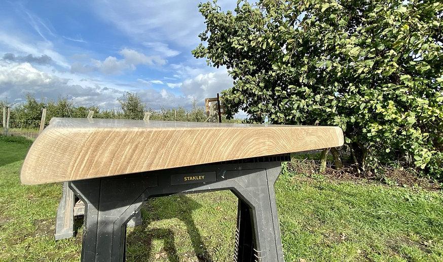live edgetable made from a waney edge oak slab .pg