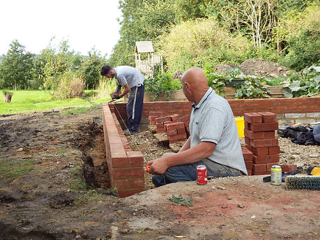 Builders in Kent finishing off the brickwork for the oak framed garage