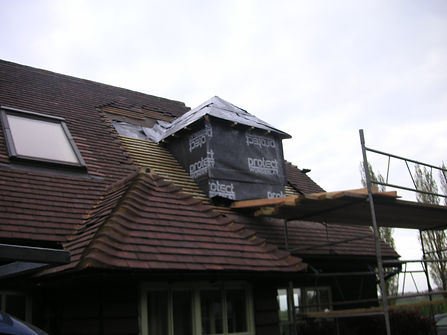 carpenters in Kent Fitting a dormer window ready for tiling