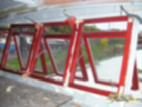 Carpenters fitting the bespoke windows that we made for the Humber keel barge