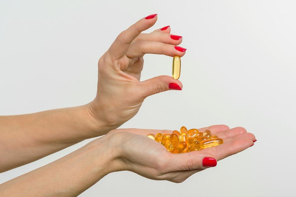 Omega 3 fish oil capsules for PMS