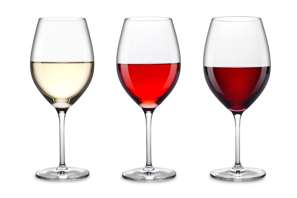 White wine, red wine and merlot on a white background.