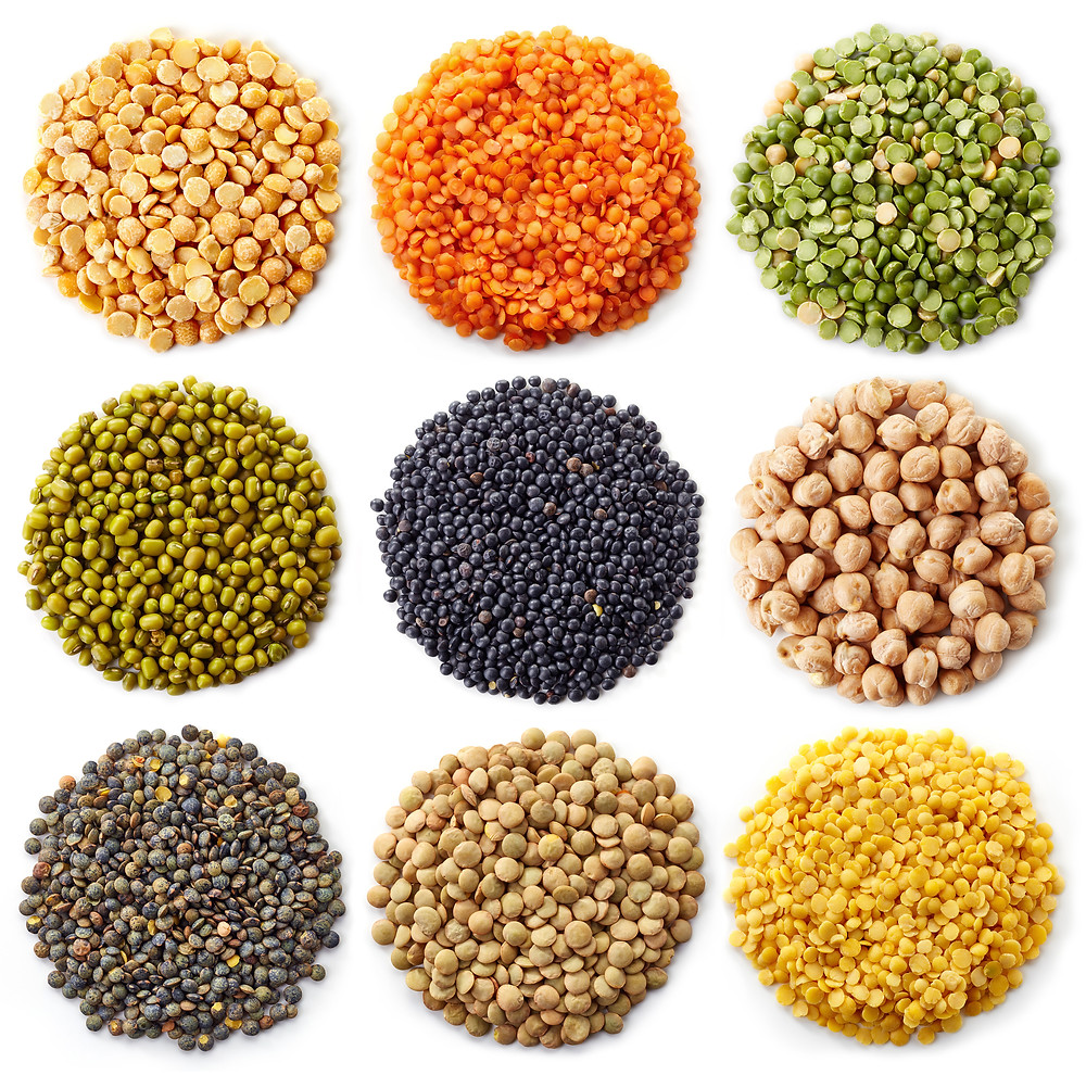 Isolated colourful lentils on a white background