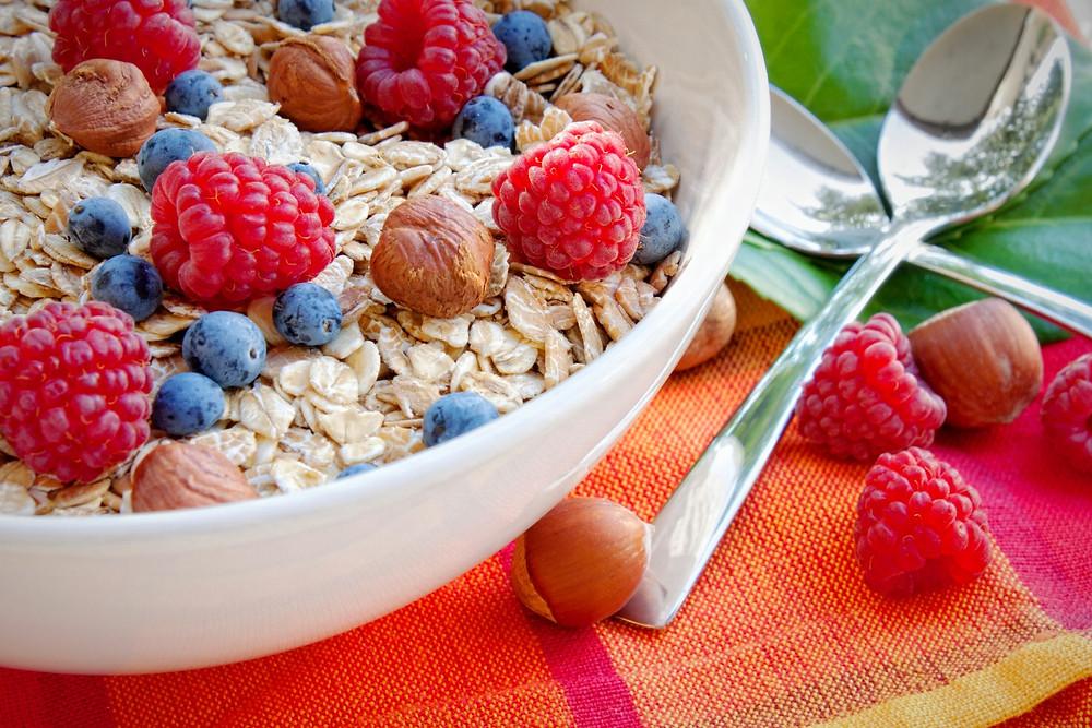 Porridge with berries, oatmeal with blueberries, raspberries and hazelnuts, Healthy breakfast