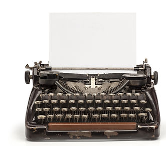 Black typewriter with  piece of paper that says hello
