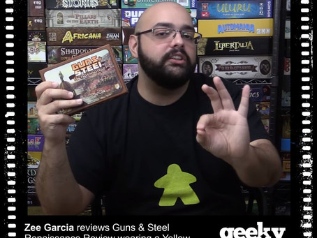 Zee Garcia Wearing a Yellow Meeple T-shirt from Geeky Goodies