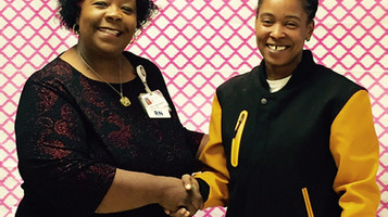 Audrey Hardy, Project Director for the Roanoke Valley Breast Cancer Coalition Receives donation from
