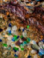 sea glass on rusted beach