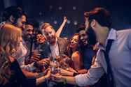 Party crowd makes a toast