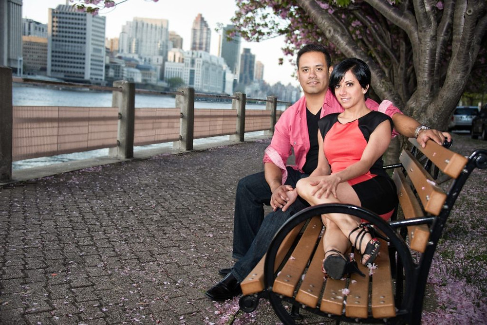 Joel Dominguez and Maria Palmieri sitting on a bench