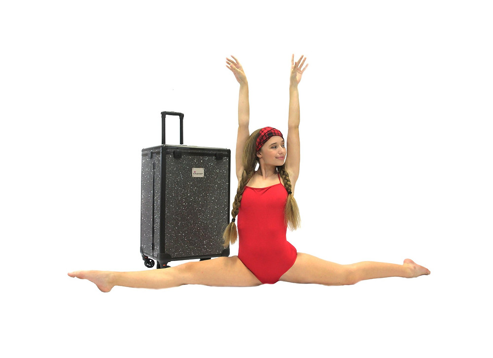 Black Divadolly suitcase and dancer in red leotard