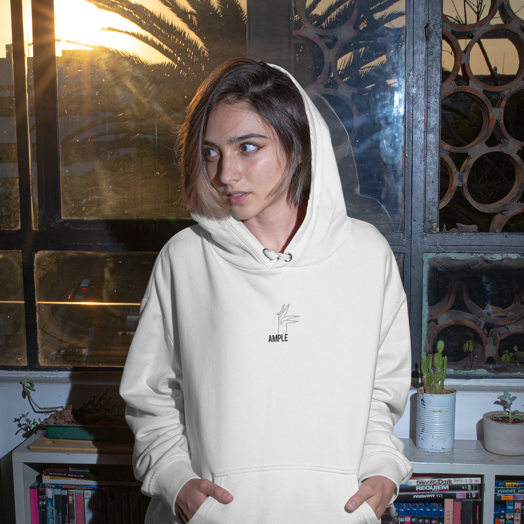 hoodie-mockup-of-a-woman-sitting-by-a-wi