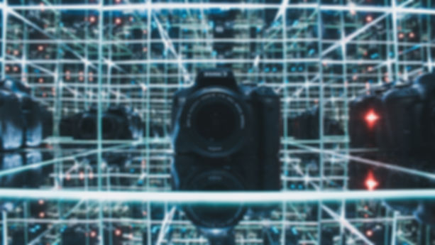 black-canon-camera-on-glass-shelf-274124